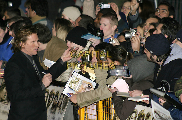 "VAL KILMER.UK film premiere of ""Alexander"",.Odeon Cinema Leicester Square, London, .January 5th 2004..half length crowd fans signing autographs.Ref: AH.www.capitalpictures.com.sales@capitalpictures.com.©Capital Pictures."