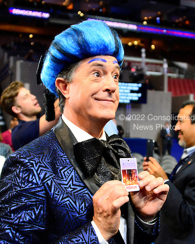 Stephen Colbert, host of The Late Show with Stephen Colbert on CBS-TV, shows off his podium pass as he practices a bit in one of the aisles of the floor prior to the 2016 Democratic National Convention held at the Wells Fargo Center in Philadelphia, Pennsylvania on Sunday, July 24, 2016.<br /> Credit: Ron Sachs / CNP<br /> (RESTRICTION: NO New York or New Jersey Newspapers or newspapers within a 75 mile radius of New York City)
