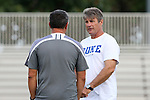 05 September 2015: Duke head coach John Kerr (right) talks with Iona head coach Fernando Barboto. The Duke University Blue Devils hosted the Iona University Gaels at Koskinen Stadium in Durham, NC in a 2015 NCAA Division I Men's Soccer match. Duke won the game 2-1.