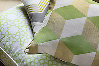 Close up of the tiny herringbone weave of a geometrically patterned scatter cushion
