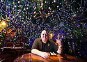 04/12/14<br /> <br /> Landlord and pub owner, Mark Thomas, 41, in the upstairs dining room.<br /> <br /> The Hanging Gate pub in Chapel en le Frith, in the Derbyshire Peak District claims to have the largest display  of Christmas decorations inside its bar and restaurants. <br /> <br /> Full story here: http://www.fstoppress.com/articles/christmas-pub/<br /> <br /> ***ANY UK EDITORIAL PRINT USE WILL ATTRACT A MINIMUM FEE OF &pound;130. THIS IS STRICTLY A MINIMUM. USUAL SPACE-RATES WILL APPLY TO IMAGES THAT WOULD NORMALLY ATTRACT A HIGHER FEE . PRICE FOR WEB USE WILL BE NEGOTIATED SEPARATELY***<br /> <br /> <br /> All Rights Reserved - F Stop Press. www.fstoppress.com. Tel: +44 (0)1335 300098