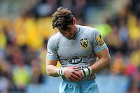 Ben Foden of Northampton Saints grasps his injured wrist in pain. Aviva Premiership match, between Wasps and Northampton Saints on April 3, 2016 at the Ricoh Arena in Coventry, England. Photo by: Patrick Khachfe / JMP
