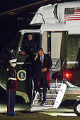 United States President Barack Obama salutes the Marine Guard as he exits Marine One on the South Lawn of the White House, on February 6, 2015, in Washington, DC.  President Obama traveled to Indianapolis, Indiana on Friday afternoon where visited Ivy Tech Community College. <br /> Credit: Drew Angerer / Pool via CNP