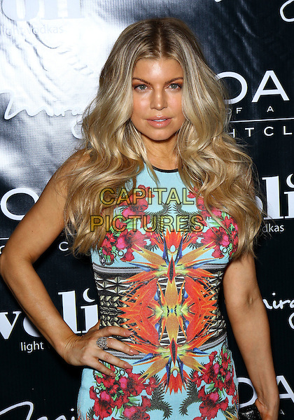 Fergie (Stacy Ferguson).Fergie Celebrates Her Birthday at 1 OAK Nightclub at The Mirage Resort Hotel and Casino, Las Vegas, Nevada, USA, 30th March 2012..half length hand on hip blue turquoise floral print dress black belt waist   pink orange .CAP/ADM/MJT.© MJT/AdMedia/Capital Pictures.