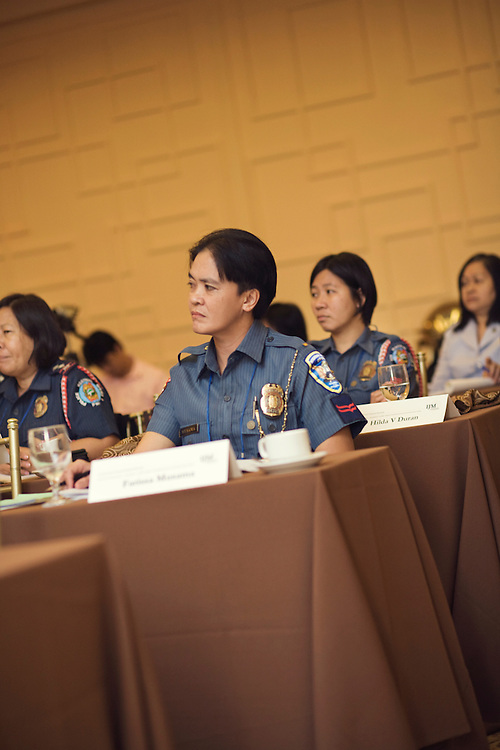 Police women sit in a conference in Manila, Philippines.