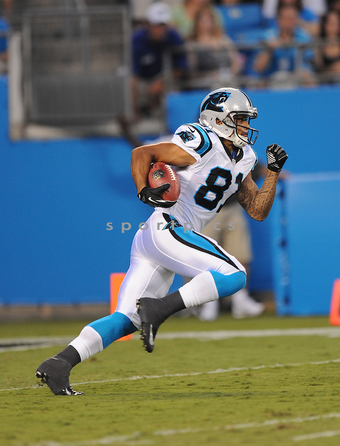 KEALOHA PILARES (81) of the Carolina Panthers, in action during the Panthers game against the Miami Dolphins on August 17, 2012 at Bank of America Stadium in Charlotte, NC. The Panthers beat the Dolphins 23-17.
