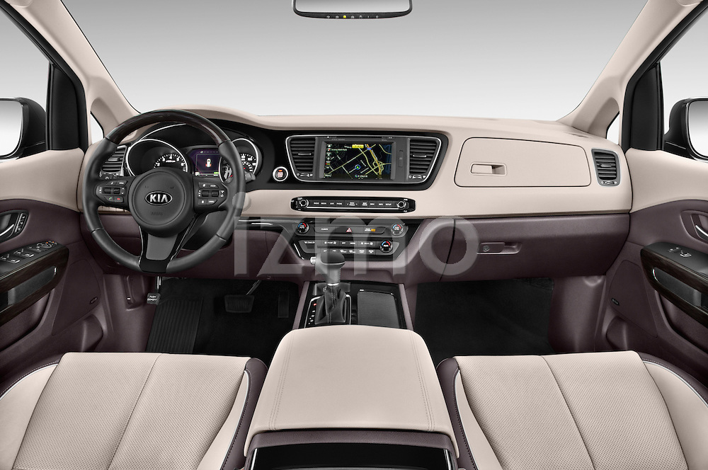 Stock photo of straight dashboard view of a 2015 KIA Sedona LX Hybrid 5 Door Mini Van