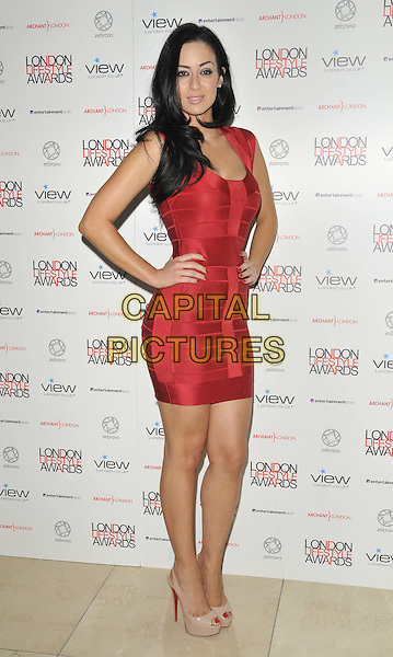 Maria Kouka  .The London Lifestyle Awards 2011, Park Plaza Riverbank hotel, Albert Embankment, London, England..October 6th, 2011.full length red dress hand on hip.CAP/CAN.©Can Nguyen/Capital Pictures.