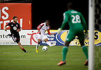 Jeremy Hall (25) of Toronto FC crosses the ball in front of Bill Hamid (28) of D.C. United while defended by Chris Korb (22) during a game at RFK Stadium in Washington, DC.  D.C. United tied Toronto FC, 1-1.