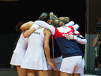 Arena Loire,  Trélazé,  France, 16 April, 2016, Semifinal FedCup, France-Netherlands, Doubles: Garcia/Mladenovic (FRA)  win the final match end advance to the final and celebrate with the team members<br /> Photo: Henk Koster/Tennisimages