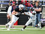 SIOUX FALLS, SD - OCTOBER 27: Ty Smith #15 from the University of Sioux Falls makes a move past Nicolas Corley #4 from Upper Iowa during their game Saturday at Bob Young Field in Sioux Falls. (Photo by Dave Eggen/Inertia)
