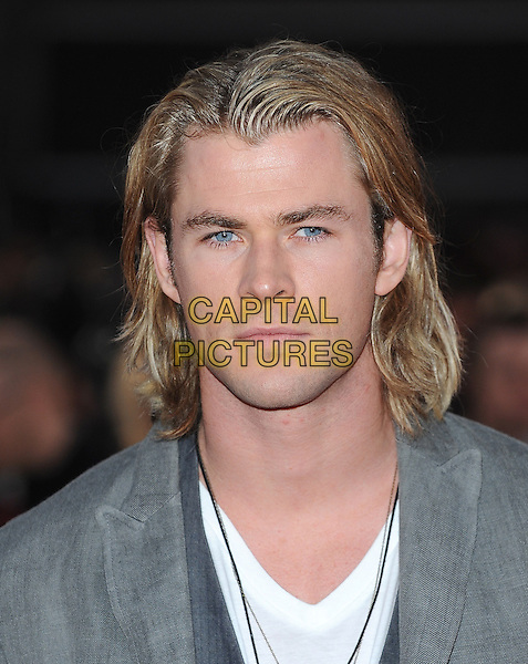 Chris Hemsworth.European Premiere of 'The Hunger Games' at Cineworld at the O2 Arena, London, England..March 14th 2012.headshot portrait necklaces white grey gray .CAP/BEL.©Tom Belcher/Capital Pictures.