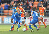 Peterborough United's Louis Reed is tackled by Blackpool's Armand Gnanduillet<br /> <br /> Photographer Kevin Barnes/CameraSport<br /> <br /> The EFL Sky Bet League One - Blackpool v Peterborough United - Saturday 13th April 2019 - Bloomfield Road - Blackpool<br /> <br /> World Copyright &copy; 2019 CameraSport. All rights reserved. 43 Linden Ave. Countesthorpe. Leicester. England. LE8 5PG - Tel: +44 (0) 116 277 4147 - admin@camerasport.com - www.camerasport.com