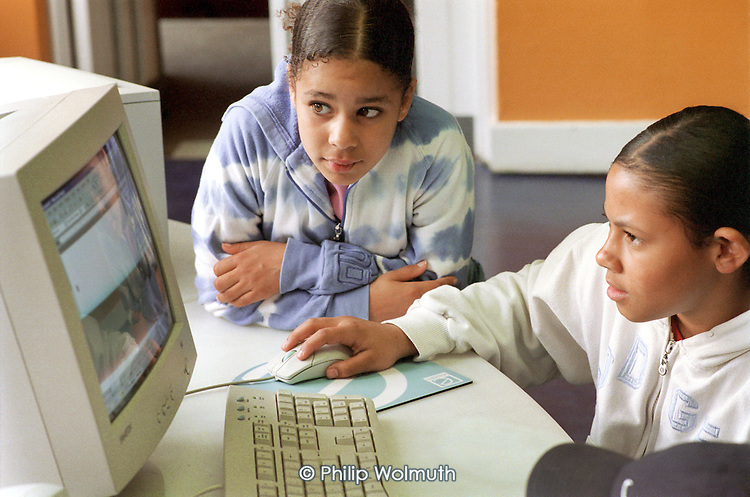 Young people use a new computer suite at a youth club on the Harrow Road, in North Paddington, newly refurbished with money from the Connexions programme.