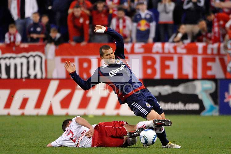 Teemu Tainio (2) of the New York Red Bulls tackles the ball from Alejandro Moreno (15) of CD Chivas USA. CD Chivas USA defeated the New York Red Bulls 3-2 during a Major League Soccer (MLS) match at Red Bull Arena in Harrison, NJ, on May 15, 2011.