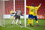Dunfermline v St Johnstone..24.12.11   SPL .Paul Willis and Paul Burns fail to prevnt Chris Smith's own goal as Murray Davidson celebrates for St Johnstone.Picture by Graeme Hart..Copyright Perthshire Picture Agency.Tel: 01738 623350  Mobile: 07990 594431