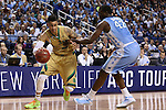 14 March 2015: Notre Dame's Zach Auguste (left) is held by North Carolina's Joel James (42). The Notre Dame Fighting Irish played the University of North Carolina Tar Heels in an NCAA Division I Men's basketball game at the Greensboro Coliseum in Greensboro, North Carolina in the ACC Men's Basketball Tournament quarterfinal game. Notre Dame won the game 90-82.