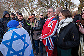Elderly Jewish woman heckler draped in an Israeli flag, argues with an Islamic preacher, Speakers' Corner, Hyde Park, London.  On leaving the park she was assaulted and pushed to the ground.