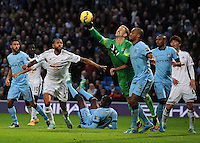 Picture: Andrew Roe/AHPIX LTD, Football, Barclays Premier League, Manchester City v Swansea City, 22/11/14, Etihad Stadium, K.O 3pm<br /> <br /> City's keeper Joe Hart punches the ball clear from Swansea's Kyle Bartley<br /> <br /> Andrew Roe>>>>>>>07826527594