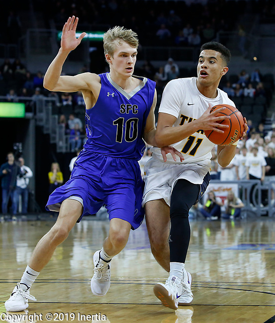 Sioux Falls, SD: MARCH 16:  Justin Hohn #11 of Tea Area drives on Mitchell Oostra #10 of Sioux Falls Christian during the 2019 South Dakota State A Boys Championship at the Denny Sanford Premier Center in Sioux Falls, SD.  (Photo by Dick Carlson/Inertia)