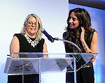 Honoree Lisa Holthouse looks over the script with the Chronicle's Melissa Aguilar at the annual Houston Chronicle's Best Dressed Luncheon at the Westin Galleria Hotel Tuesday April 3, 2013.(Dave Rossman photo)