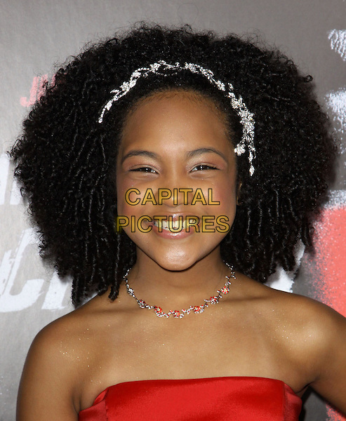 "EMERALD-ANGEL YOUNG.Premiere Screening Of Overture Films' ""Law Abiding Citizen"" held At The Grauman Chinese Theatre, Hollywood, California, USA..October 6th, 2009.headshot portrait white headband alice band curly hair red strapless .CAP/ADM/KB.©Kevan Brooks/AdMedia/Capital Pictures."
