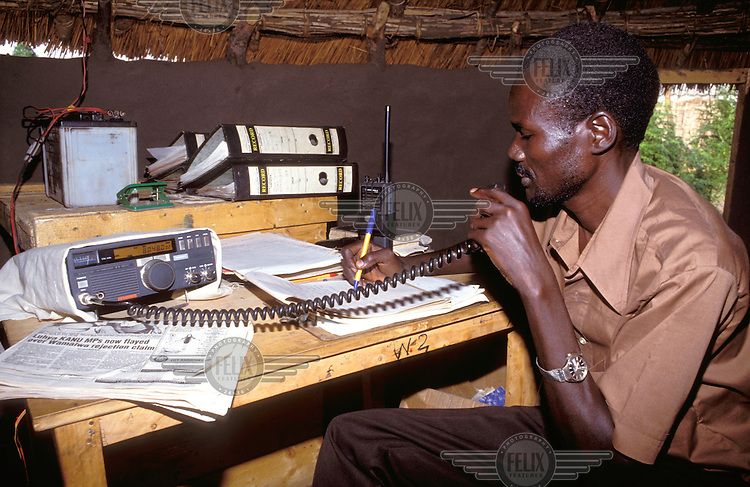 © Crispin Hughes / Panos Pictures..Nimule, Southern SUDAN..Radio operator at the headquarters of an aid agency..