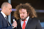 The Welsh rugby team celebrate winning the Grand Slam in the Six Nations rugby tournament at The Senydd in Cardiff Bay..Adam Jones being interviewed by BBC TV sports presenter Jason Mohammed.