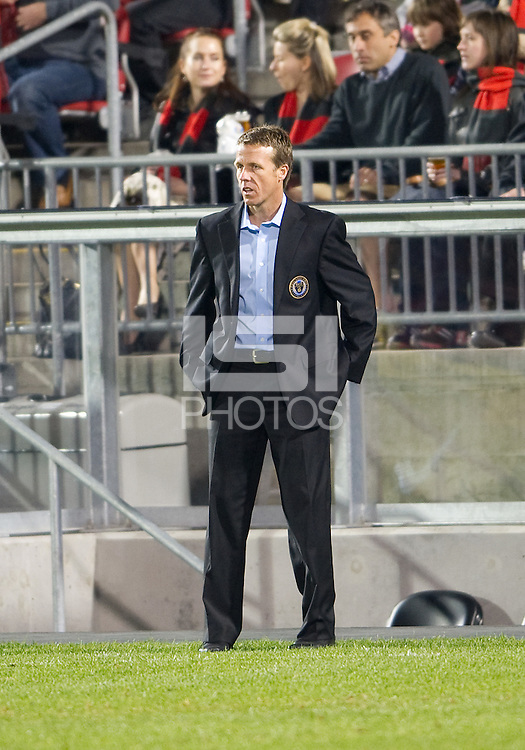 15 April 2010: Philadelphia Union head coach Peter Nowak watches his team during a game between the Philadelphia Union and Toronto FC at BMO Field in Toronto..Toronto FC won 2-1..Photo by Nick Turchiaro/isiphotos.com.