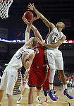 SIOUX FALLS, SD - MARCH 9: James Hunter #50 of USD, Connor DeVine #30 and Skyler Flatten #1 of SDSU fight for the ball in the first half of their semi-final round Summit League Championship Tournament game Monday evening at the Denny Sanford Premier Center in Sioux Falls, SD. (Photo by Dick Carlson/Inertia)
