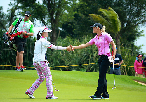 06.03.2014. Haikou, China; Shi Yuting of China and Suzann Pettersen of Norway during round one of the World Ladies Championship at Mission Hills Blackstone Course.