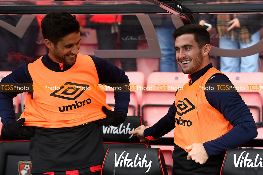 Andrew Surman of AFC Bournemouth left and Lewis Cook of AFC Bournemouth share a joke in the dugout before kick off during AFC Bournemouth vs Arsenal, Premier League Football at the Vitality Stadium on 25th November 2018
