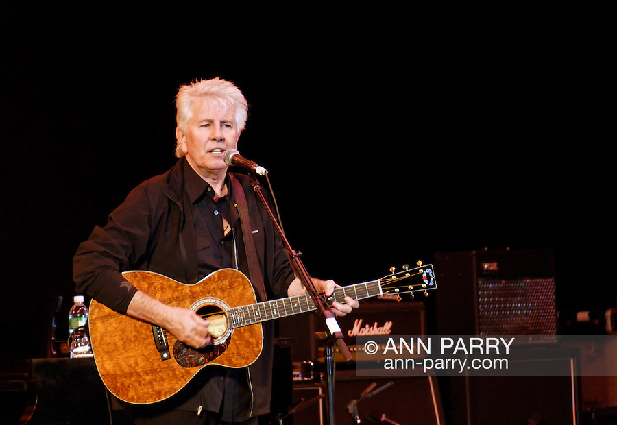 East Meadow, NY - OCTOBER 15: Closeup of musician Graham Nash singing and playing guitar on stage at Obama Rally and concert at Eisenhower Park October 15, 2008 in East Meadow, New York, near the site of final presidential debate held later that night.