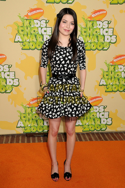 MIRANDA COSGROVE .Nickelodeon's 2009 Kids' Choice Awards held at the UCLA Pauley Pavilion, Westwood, CA. USA, .28th March 2009..full length black and white heart print dress belt pockets  shoes bow open toe tulle .CAP/ADM/BP.©Byron Purvis/Admedia/Capital PIctures