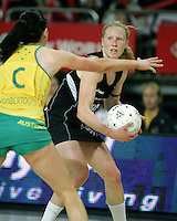 20.09.2008 Silver Ferns Laura Langman and Australia's Natalie Von Bertouch in action during the New World Netball test match between the Silver Ferns and Australia played at Vector Arena in Auckland Mandatory Photo Credit ©Michael Bradley.