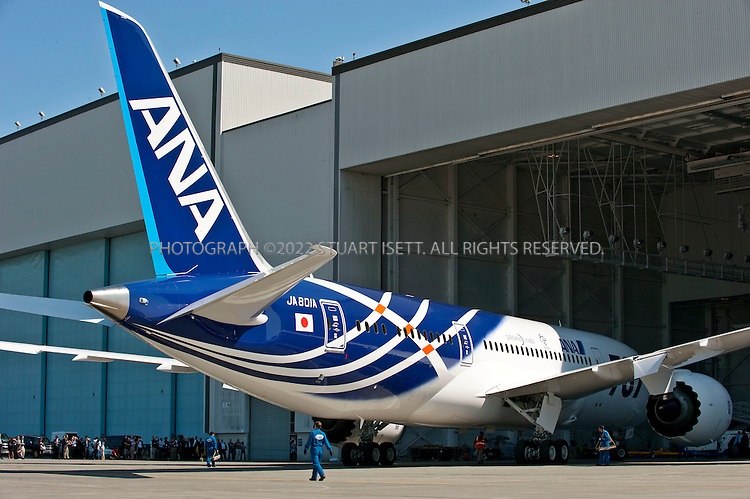 8/8/2011--Everett, WA, USA..The first Boeing 787 Dreamliner delivered to a customer, ANA, is backed out of the hanger at Boeing facilities in Everett, WASH...Boeing presented the first 787 Dreamliner to launch customer ANA (All Nippon Airways) at Paine Field in Everett, WASH., north of Seattle. The new planes's first commercial flight will be a special charter from Tokyo to Hong Kong...©2011 Stuart Isett. All rights reserved.