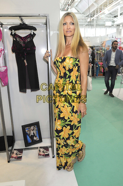 Caprice Bourret.showing her new lingerie collection at 'Pure London 2012', Olympia, Kensington, London, England..20th August 2012.full length black yellow green floral print dress strapless fashion .CAP/BK/PP.©Bob Kent/PP/Capital Pictures.