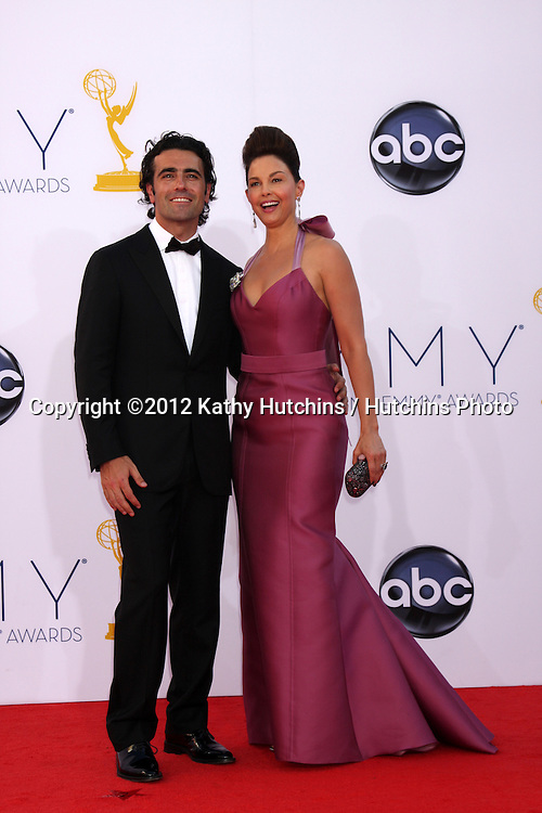 LOS ANGELES - SEP 23:  Dario Franchitti, Ashley Judd arrives at the 2012 Emmy Awards at Nokia Theater on September 23, 2012 in Los Angeles, CA