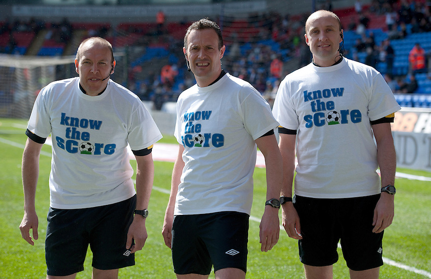 Referee Darren Deadman and his assistant referees pose before the match with t-shirts bearing the logo Know The Score.. - (Photo by Stephen White/CameraSport) - ..Football - npower Football League Championship - Bolton Wanderers v Middlesbrough - Saturday 20th April 2013 - Reebok Stadium - Bolton..© CameraSport - 43 Linden Ave. Countesthorpe. Leicester. England. LE8 5PG - Tel: +44 (0) 116 277 4147 - admin@camerasport.com - www.camerasport.com
