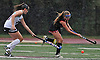 Katarina Mongiardo #11 of Friends Academy, right, gets pressured by Jenny Walton #10 of North Shore during a rain-filled Nassau County League 3 varsity field hockey game at North Shore High School in Glen Head on Thursday, Oct. 11, 2018. North Shore won by a score of 3-1.