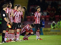 Lincoln City's Tom Pett, second in from right, during the penalty shoot out<br /> <br /> Photographer Chris Vaughan/CameraSport<br /> <br /> The EFL Checkatrade Trophy Northern Group H - Lincoln City v Wolverhampton Wanderers U21 - Tuesday 6th November 2018 - Sincil Bank - Lincoln<br />  <br /> World Copyright © 2018 CameraSport. All rights reserved. 43 Linden Ave. Countesthorpe. Leicester. England. LE8 5PG - Tel: +44 (0) 116 277 4147 - admin@camerasport.com - www.camerasport.com<br /> <br /> Photographer Chris Vaughan/CameraSport<br /> <br /> The EFL Checkatrade Trophy Northern Group H - Lincoln City v Wolverhampton Wanderers U21 - Tuesday 6th November 2018 - Sincil Bank - Lincoln<br />  <br /> World Copyright © 2018 CameraSport. All rights reserved. 43 Linden Ave. Countesthorpe. Leicester. England. LE8 5PG - Tel: +44 (0) 116 277 4147 - admin@camerasport.com - www.camerasport.com