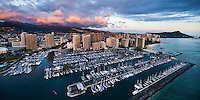 An aerial view of Ala Wai Boat Harbor and Waikiki, with Diamond Head on the distant right and pink clouds gracing the top of the Ko'olau Range at Manoa on the distant left, O'ahu.