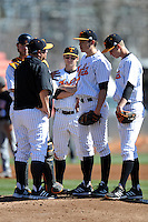 Tennessee Volunteers catcher David Houser #22 third baseman Taylor Smart #2 and shortstop A.J.Simcox #10 listen in as head coach Dave Serrano #12 talks with starting pitcher Kyle Serrano #11 during a game against the UNLV Runnin' Rebels at Lindsey Nelson Stadium on February 22, 2014 in Knoxville, Tennessee. The Volunteers defeated the Rebels 5-4. (Tony Farlow/Four Seam Images)