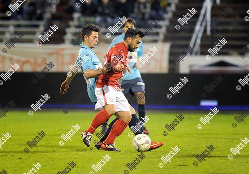 2013-11-23 / Vetbal / seizoen 2013-2014 / R. Antwerp FC - Hoogstraten / Emrullah G&uuml;ven&ccedil; (Antwerp) met Ruben Tilburgs in de rug<br /><br />Foto: Mpics.be