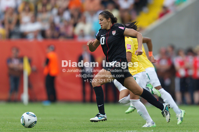 DRESDEN, GERMANY - JULY 10:  Carli Lloyd of the United States races for the ball during the FIFA Women's World Cup quarterfinal match against Brazil at Rudolf Harbig Stadium on July 10, 2011  in Dresden, Germany.  Editorial use only.  Commercial use prohibited.  No push to mobile device usage.  (Photograph by Jonathan P. Larsen)