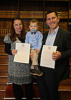 Young Ibrahim Husejni (C) with his father Raman Husejni (R) and his mother at the Citizenship Ceremony at Carmarthen Register Office, Carmarthenshire, Wales, UK. Monday 22 August 2016