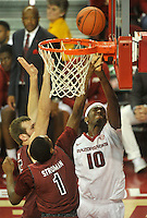 NWA Democrat-Gazette/Michael Woods --02/03/2015--w@NWAMICHAELW... University of Arkansas forward Bobby Portis drives to the hoop past South Carolina defenders during the second half of Tuesday nights game against the South Carolina Gamecocks at Bud Walton Arena in Fayetteville.