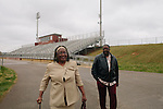 "The late Anthony ""Speedy"" Cannon's cousin Raymond Woodruff walks alongside Pamela Baker-King outside of Jacksonville High School in Jacksonville, Alabama."