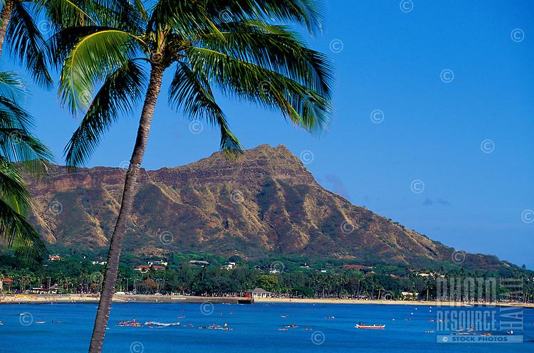 Canoe and swimmers off Waikiki beach and Diamond Head,