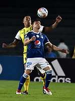 BOGOTA - COLOMBIA - 22 – 03 - 2018: Cristian Huerfano (Der.) jugador de Millonarios disputa el balón con Cristian Florez (Izq.) jugador de Alianza Petrolera, durante partido aplazado de la fecha 8 entre Millonarios y por la Liga Aguila I 2018, jugado en el estadio Nemesio Camacho El Campin de la ciudad de Bogota. / Cristian Huerfano (R) player of Millonarios vies for the ball with Cristian Florez (L) player of Alianza Petrolera, during a posponed match of the 8th date between Millonarios and Alianza Petrolera, for the Liga Aguila I 2018 played at the Nemesio Camacho El Campin Stadium in Bogota city, Photo: VizzorImage / Luis Ramirez / Staff.